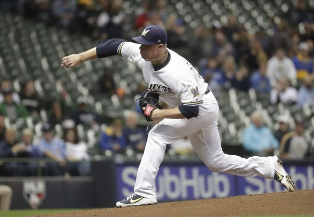 Milwaukee Brewers starting pitcher Chase Anderson throws during the first inning of a baseball game against the Arizona Diamondbacks Monday, May 21, 2018, in Milwaukee. (AP Photo/Morry Gash)