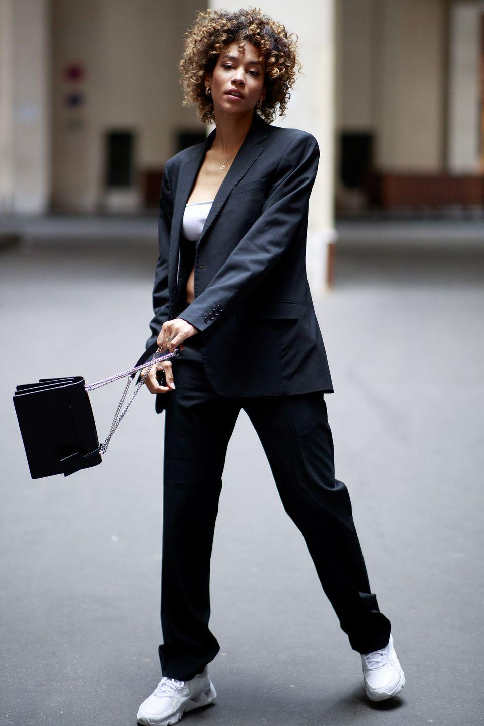 <p>Pairing a classic trouser suit with sporty trainers is one of the easiest ways to perfect high-low dressing. </p>