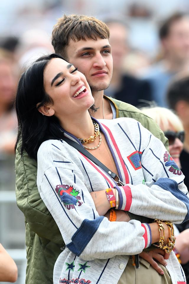 """Dua Lipa and Anwar Hadid, a.k.a. Gigi and Bella's little brother, have yet to confirm that they are officially together. But the two were spotted looking <em>extremely</em> couple-y <a href=""""https://people.com/music/dua-lipa-anwar-hadid-kiss-cozy-up-london/"""">at a music festival in London</a> in June."""