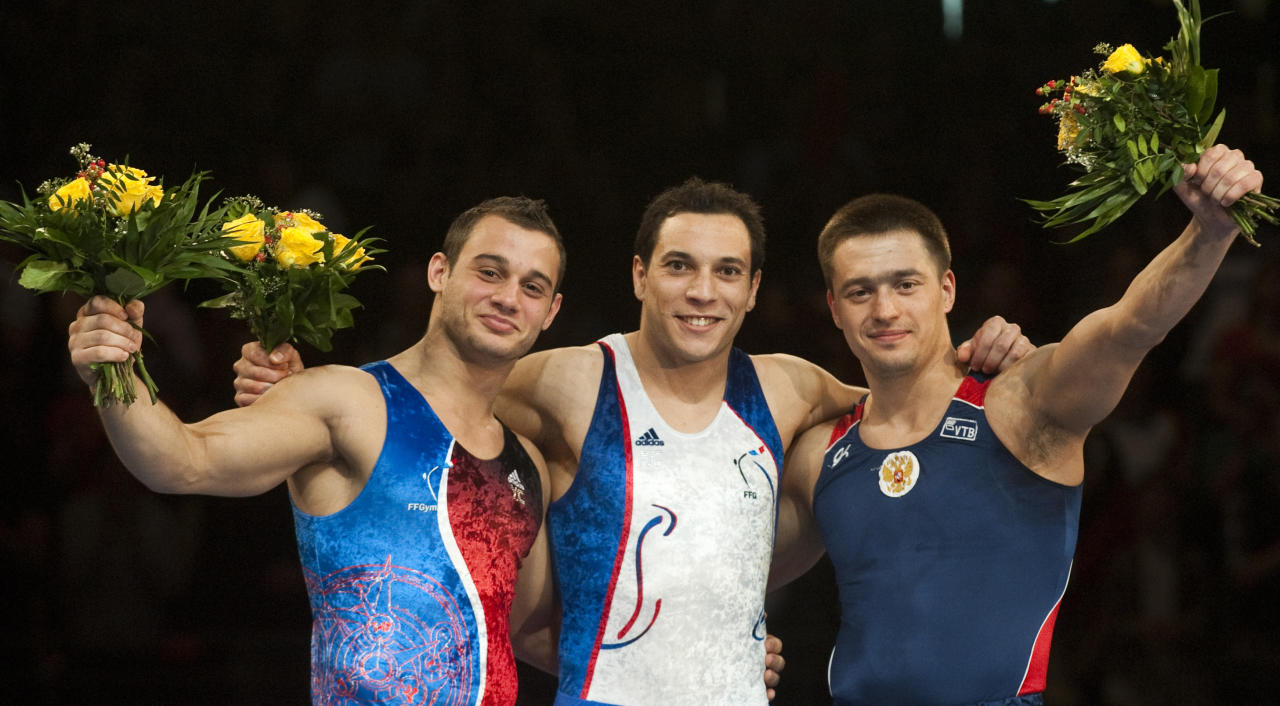 (From L) France's Samir Ait Said (silver), France's Thomas Bouhail (gold) and Russia's Anton Golotsutskov celebrate on the podium during a victory ceremony in the men's apparatus finals on the vault during the 4th European Artistic Gymnastics Championships in Berlin on April 10, 2011. AFP PHOTO / JOHN MACDOUGALL (Photo credit should read JOHN MACDOUGALL/AFP/Getty Images)