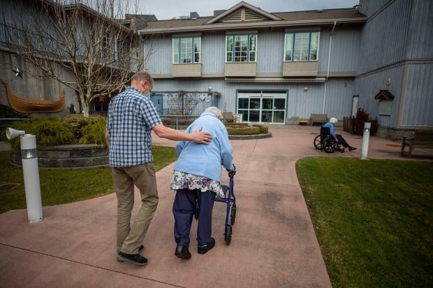 A visitor and resident are seen at the Normanna care home for seniors in Burnaby, B.C., on April 1. The province's long-term care facilities are reopening to visits by those who are fully vaccinated.  (Ben Nelms/CBC - image credit)