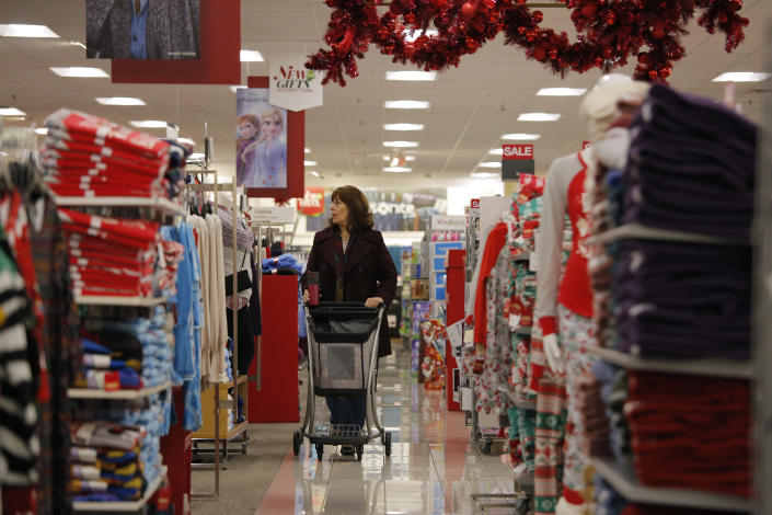 FILE - In this Nov. 27, 2019, file photo Robin Hazal shops at a Kohl's ahead of Black Friday in Las Vegas. The nation's largest retail trade group said Thursday, Jan. 16, 2020, that holiday sales increased 4.1%, near the top end of its forecast. (AP Photo/John Locher)