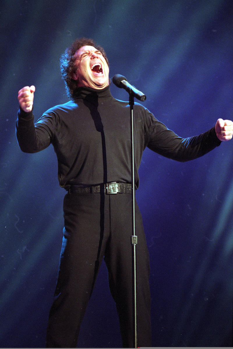 """FILE - In this Jan. 30, 1995 file photo, Tom Jones, co-host of the American Music Awards, sings """"I Wanna Get Back With You"""" during his performance segment of the telecast at the Shrine Auditorium in Los Angeles. Hal David, the stylish, heartfelt lyricist who teamed with Burt Bacharach on dozens of timeless songs for movies, television and a variety of recording artists in the 1960s and beyond, died Saturday, Sept. 1, 2012. He was 91. David and Bacharach wrote the lyrics for """"What's New Pussycat,"""" made famous by Jones. (AP Photo/Reed Saxon, File)"""