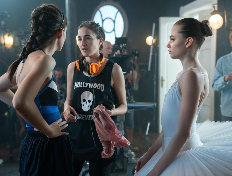 """Director Sarah Adina Smith (center) goes over a scene with Diana Silvers and Kristine Froseth on the set of """"Birds of Paradise."""""""