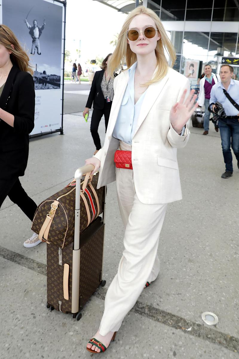 Elle Fanning seen arriving at Nice airport (MCvitanovic / SplashNews.com)