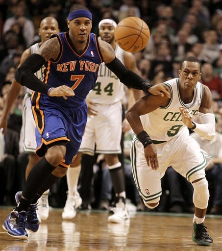 New York Knicks' Carmelo Anthony (7) and Boston Celtics' Rajon Rondo eye a loose ball during the second quarter of an NBA basketball game in Boston, Friday, Feb. 3, 2012. (AP Photo/Winslow Townson)