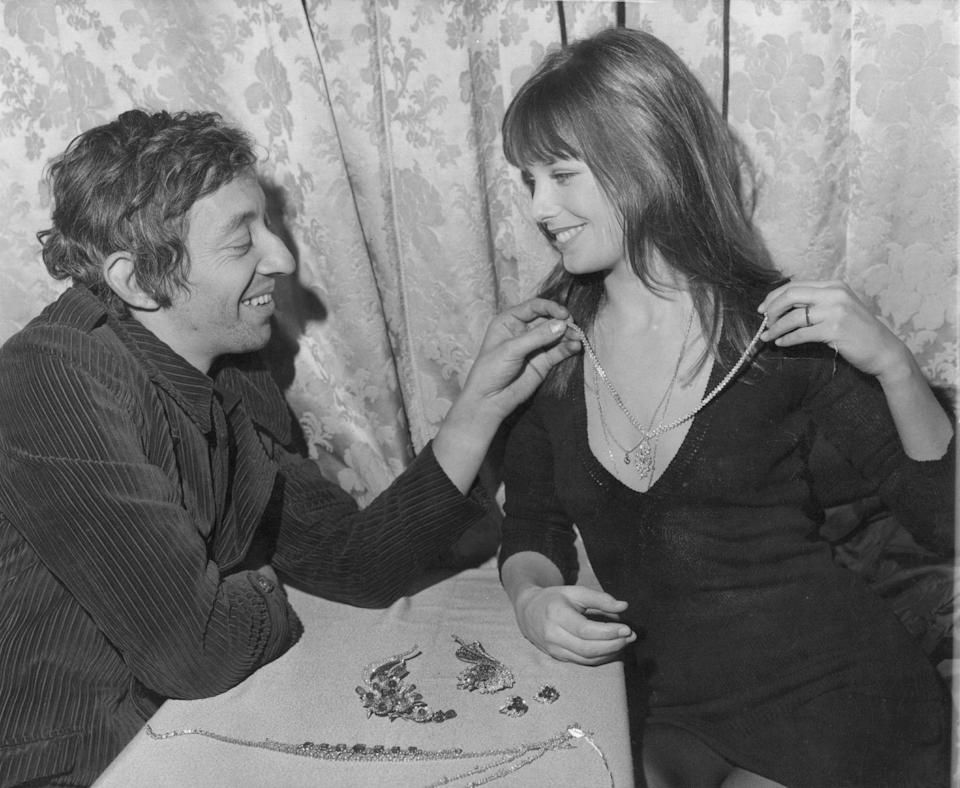 <p>Serge Gainsbourg took his girlfriend, Jane Birkin, shopping for an expensive Christmas gift in 1969. The French singer wore a fashionable dark corduroy jacket for the outing. </p>