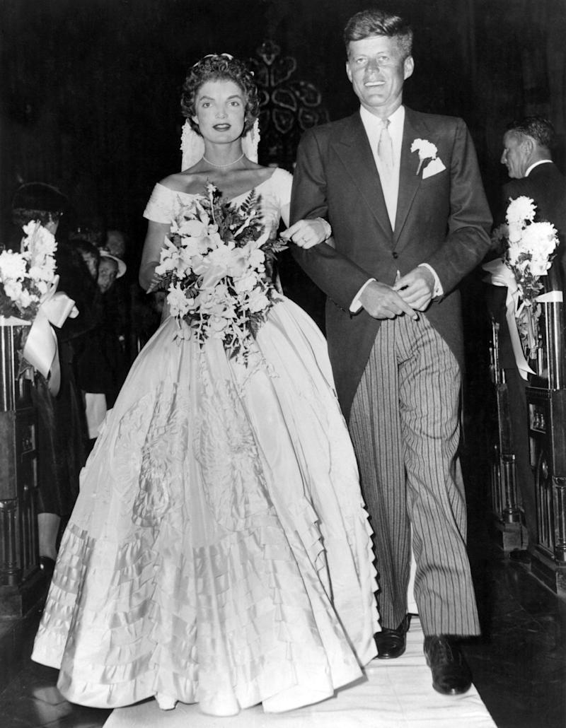 Senator John Fitzgerald Kennedy (1917 - 1963), Democratic senator for Massachusetts, escorts his bride Jacqueline Lee Bouvier (1929 - 1994) down the church aisle shortly after their wedding ceremony at Newport, Rhode Island. (Photo by Keystone/Getty Images)