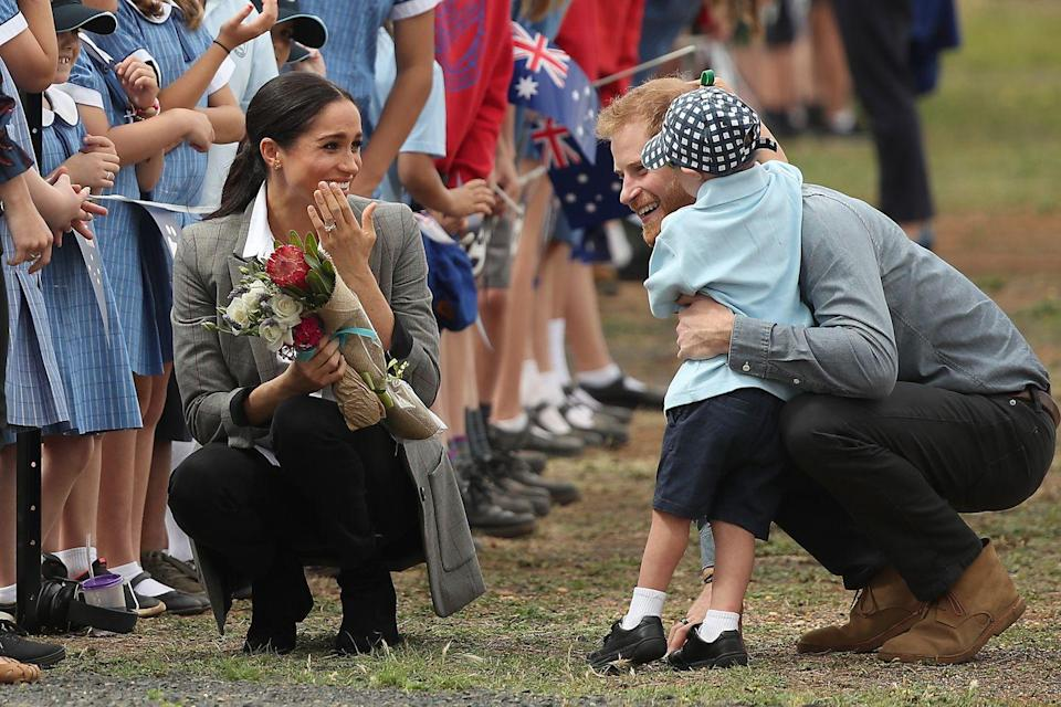 <p>William, Kate, Harry, and Meghan often have the cutest moments in public when they're seen crouched down and interacting with children. They don't shy again from a big hug, either!</p>