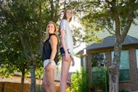 ***EXCLUSIVE VIDEO AVAILABLE*** AUSTIN, TX, USA - 11 AUGUST 2019: 16-year-old Maci Currin, whose 53 inch long legs are believed to be the world's longest, towers over her mother Trish as the pair stand back-to-back on 11 August, 2019, in Austin, Texas. A TOWERING teenager from Texas is about to strut her way into the record books as the proud owner of the world's longest legs. Aged only 16, Maci Currin, from Austin, Texas, has legs measuring an incredible 53 inches - smashing the previous record of 52.2 inches held by Ekaterina Lisina, of Russia. The 6ft 9in aspiring model was only 19 inches when born, but a series of growth spurts meant she rocketed to 5ft 7in by the time she was nine years old. Maci also has an inseam of 43 inches and has to stoop to avoid banging her head when walking through doors, but says she is proud of her lengthy limbs despite the added attention they bring. PHOTOGRAPH BY: Bradley Beesley / Barcroft Media (Photo credit should read Bradley Beesley / Barcroft Media / Barcroft Media via Getty Images)