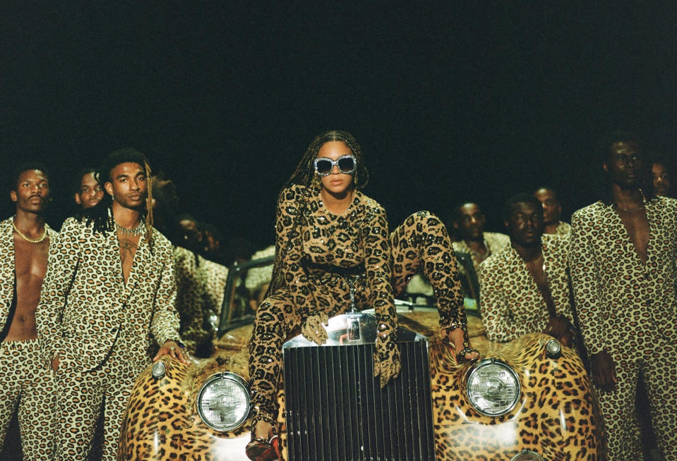 """This image released by Disney Plus shows Beyonce Knowles, center, in a scene from her visual album """"Black is King."""" The pop star scored multiple Grammy nominations Tuesday, making her the leading contender with nine nominations. (Travis Matthews/Disney Plus via AP)"""
