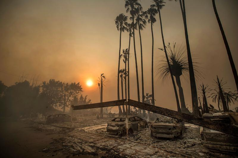 In this Dec. 5, 2017 file photo, smoke rises behind a destroyed apartment complex as a the Thomas wildfire burns in Ventura, Calif. (Photo: ASSOCIATED PRESS)