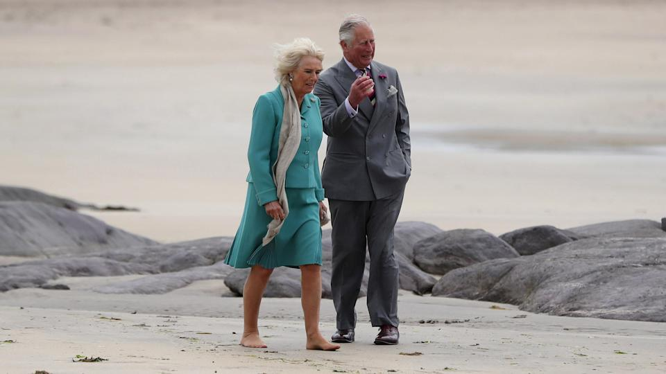 Earlier this year, Camilla chose to go barefoot, however, kept her nude tights on during a beach visit in Northern Ireland. Photo: Getty