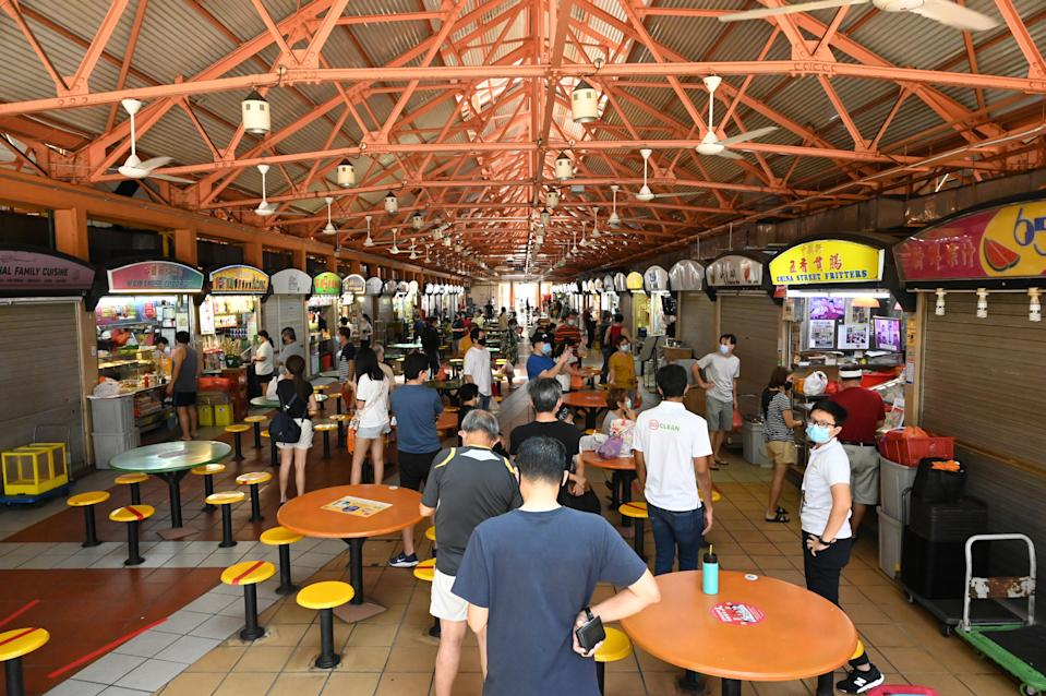 People buying food at a hawker centre in Singapore.