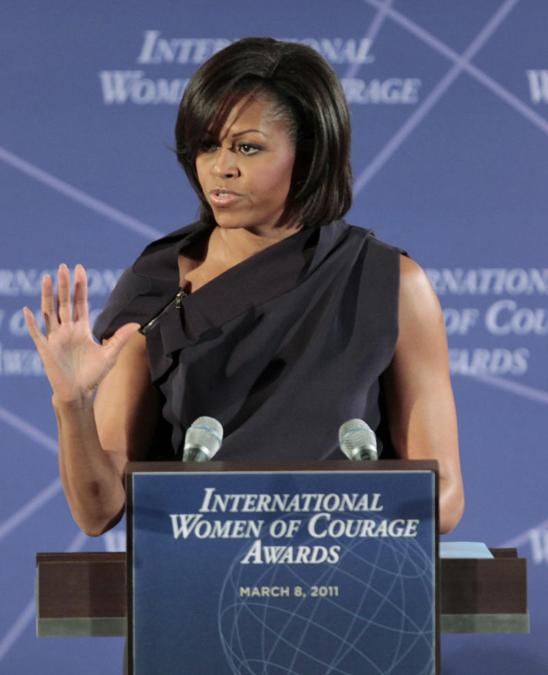 First Lady Michelle Obama speaks at the 2011 International Women of Courage Awards ceremony at the State Department in Washington, Tuesday, March 8, 2011. (AP Photo/Luis M. Alvarez)
