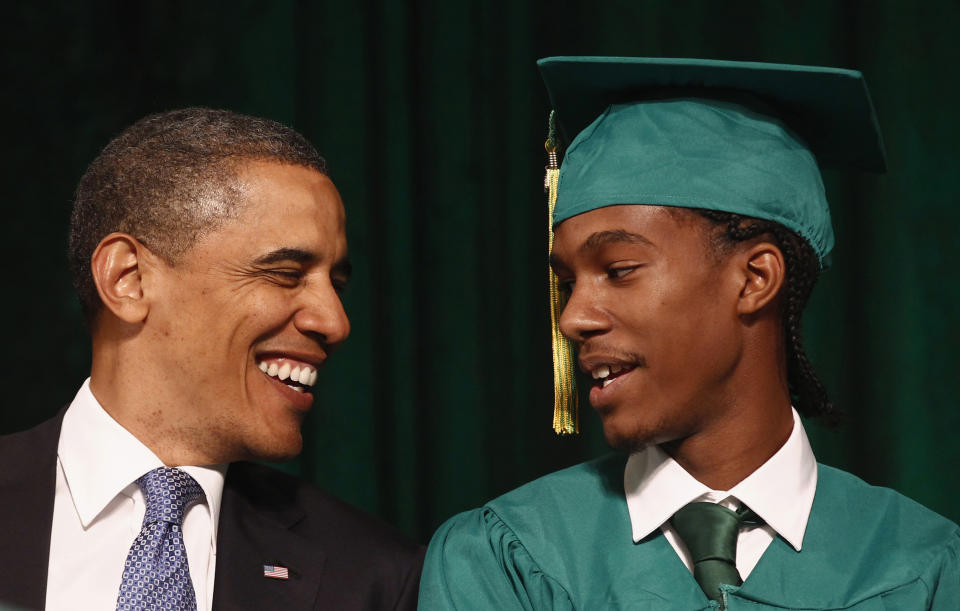U.S. President Barack Obama (L) talks with student Christopher Dean before Dean introduced Obama to deliver the commencement address for Booker T. Washington High School in Memphis, Tennessee May 16, 2011.   REUTERS/Kevin Lamarque  (UNITED STATES - Tags: POLITICS EDUCATION IMAGES OF THE DAY)