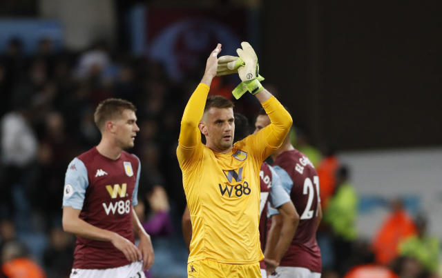 Aston Villa's goalkeeper Thorn Heaton applauds to supporters at the end of the English Premier League soccer match between Aston Villa and West Ham United at Villa Park in Birmingham, England, Monday, Sept. 16, 2019. (AP Photo/Rui Vieira)