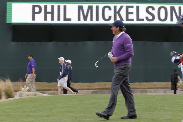 Phil Mickelson smiles as he walks to the 16th green during the second round of the Phoenix Open golf tournament on Friday, Jan. 31, 2014, in Scottsdale, Ariz. (AP Photo/Ross D. Franklin)