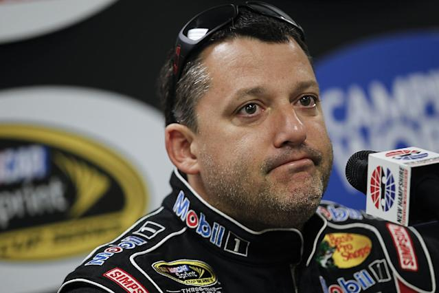 FILE - In this July 12, 2013 file photo, NASCAR driver Tony Stewart speaks at a press conference prior to NASCAR practice at the New Hampshire Motor Speedway in Loudon, N.H. Stewart is skipping a second straight Sprint Cup race, and it is not clear when the NASCAR star might return after he struck and killed a driver at a dirt-track race in New York last weekend. (AP Photo/Cheryl Senter, File)