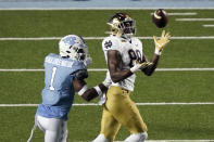 Notre Dame wide receiver Javon McKinley (88) catches a pass as North Carolina defensive back Kyler McMichael (1) defends during the second half of an NCAA college football game in Chapel Hill, N.C., Friday, Nov. 27, 2020. (AP Photo/Gerry Broome)