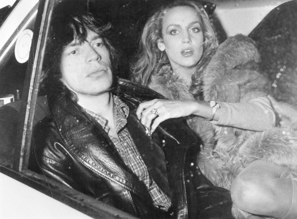 <p>Mick Jagger travels in the back seat of a car with his girlfriend Jerry Hall, in Paris, 1979.</p>