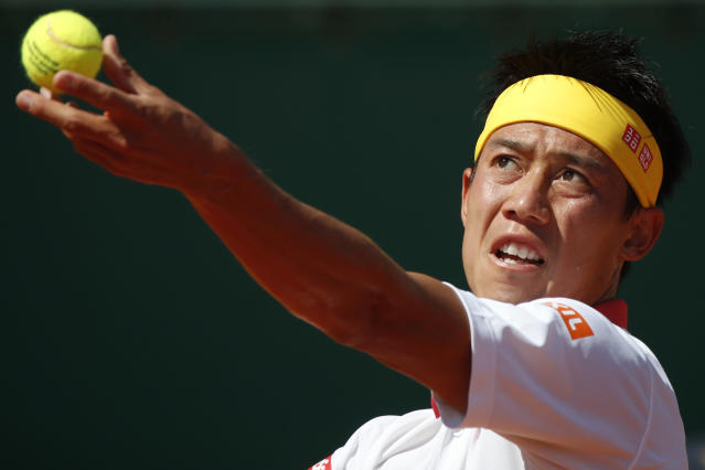 Japan's Kei Nishikori prepares to serve against Spain's Rafael Nadal during the men's singles final match of the Monte Carlo Tennis Masters tournament in Monaco, Sunday April 22, 2018. (AP Photo/Christophe Ena)