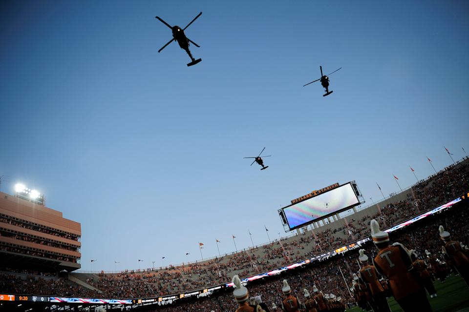 Army Black Hawk helicopters pass overhead during a game at Neyland Stadium on Sept. 2.
