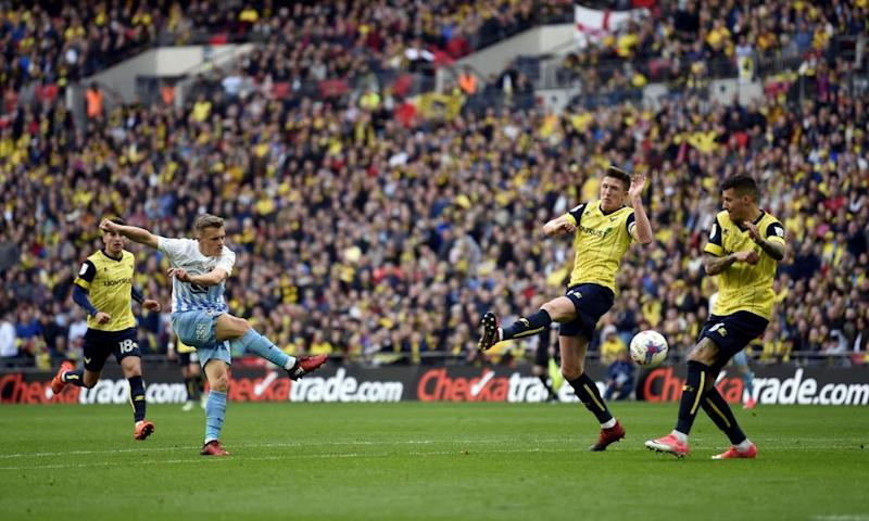 Coventry's George Thomas scores his side's second goal at Wembley. Liam Sercombe pulled one back for Oxford with 15 minutes left, but Coventry held on to win the EFL Trophy.