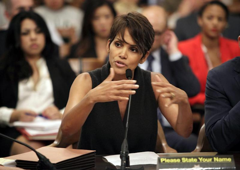 Actress Halle Berry testifies before the Assembly Committee on Public Safety at the Capitol in Sacramento, Calif., for a bill that would limit the ability of paparazzi to photograph children of celebrities and public figures on Tuesday, June 25, 2013. (AP Photo/Steve Yeater)