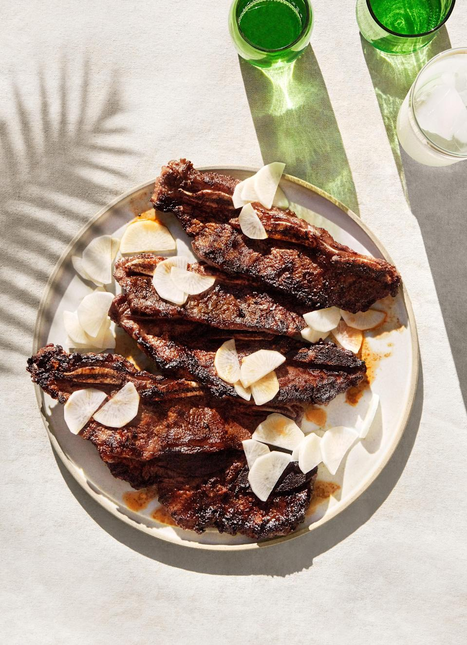 "If you've ever had kalbi at a Korean barbecue restaurant, you've had grilled flanken-style short ribs. For this recipe, look for them prepackaged in the meat case, or ask your butcher. This concentrated, aromatic, spicy-sweet chile paste seasons the ribs robustly in as little as 15 minutes. <a href=""https://www.bonappetit.com/recipe/grilled-chile-lemongrass-short-ribs-with-pickled-daikon?mbid=synd_yahoo_rss"" rel=""nofollow noopener"" target=""_blank"" data-ylk=""slk:See recipe."" class=""link rapid-noclick-resp"">See recipe.</a>"