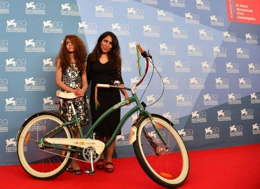 """Director Haifaa Al Mansour (R) and actress Waad Mohammed pose during the photocall of """"Wadjda"""" at the 69th Venice Film Festival"""