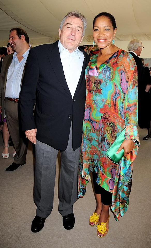 """Robert De Niro appeared to be hypnotized by wife Grace Hightower's swirling print dress. Dave M. Benett/<a href=""""http://www.gettyimages.com/"""" target=""""new"""">GettyImages.com</a> - June 25, 2008"""