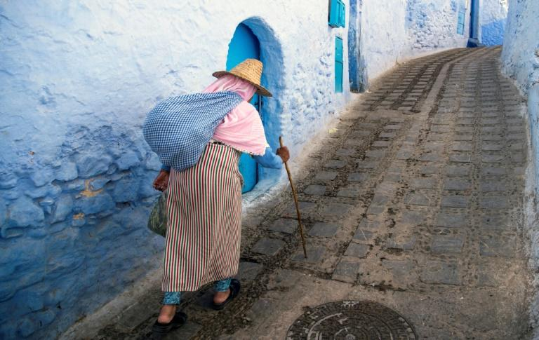 A woman walks in the medina of the northwestern Moroccan city of Chefchaouen