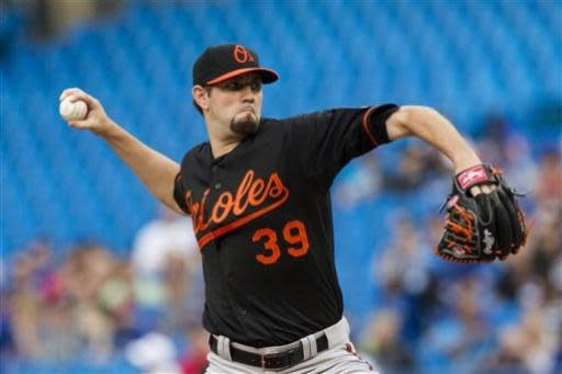 Baltimore Orioles starting pitcher Jason Hammel works against Toronto Blue Jays during the first inning of a baseball game in Toronto on Friday, June 21, 2013. (AP Photo/The Canadian Press, Chris Young)