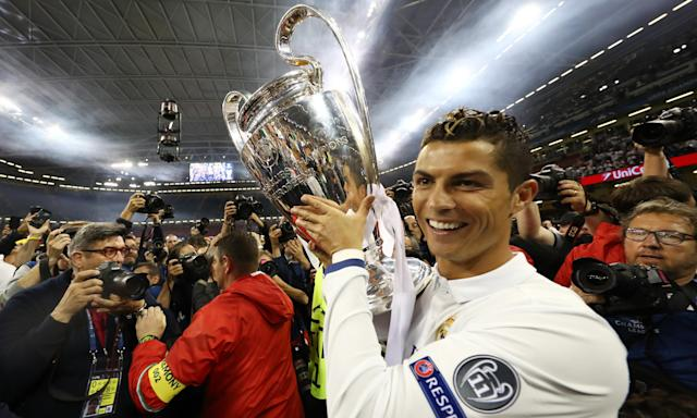 Real Madrid's Cristiano Ronaldo celebrates with the Champions League trophy after beating Juventus in Cardiff last season. The holders - preparing for a fourth final in five years - have a habit of making everyone feel inferior.
