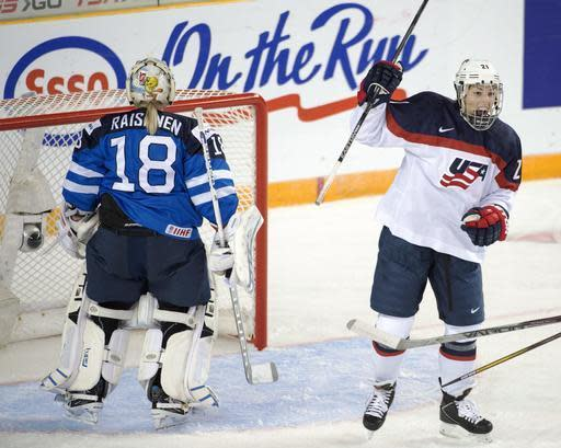 "FILE - In this March 29, 2016, file photo, United States' Hilary Knight celebrates after scoring against Finland goaltender Meeri Raisanen during a women's world hockey championships game in Kamloops, British Columbia. USA Hockey and representatives of the women's national team will meet Monday, March 20, 2017, to discuss a wage dispute that could lead to players boycotting the upcoming world championships. Knight said Friday, March 17, 2017, that it was her hope that USA Hockey would ""reach out to our lawyers and present something that's worth sitting down to the table for."" (Ryan Remiorz/The Canadian Press via AP, File)"