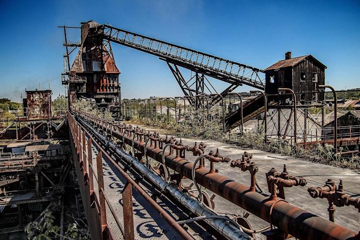 """<p>""""They call the steel mill a 'temporary home,' as they create their masterpieces inside the unused buildings."""" (Photo: Abandoned Southeast/Caters News) </p>"""