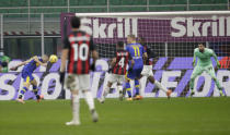 Parma's Jasmin Kurtic, left, scores his side's second goal during a Serie A soccer match between AC Milan and Parma, at the San Siro stadium in Milan, Italy, Sunday, Dec. 13, 2020. (AP Photo/Luca Bruno)