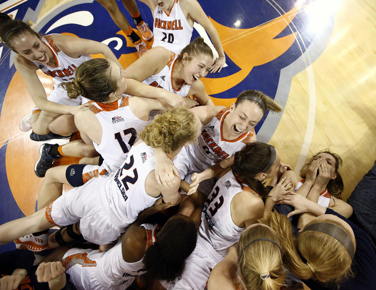 <p>Bucknell celebrates at centercourt after defeating Navy in overtime of an NCAA college basketball Patriot League Championship game in Lewisburg, Pa., March 12, 2017. (Photo: Chris Knight/AP) </p>