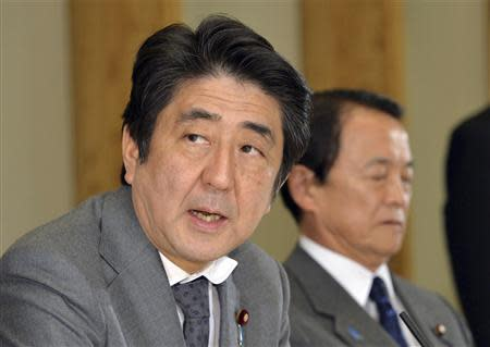 Japan's PM Abe addresses at a meeting of the economy and fiscal policy council in Tokyo