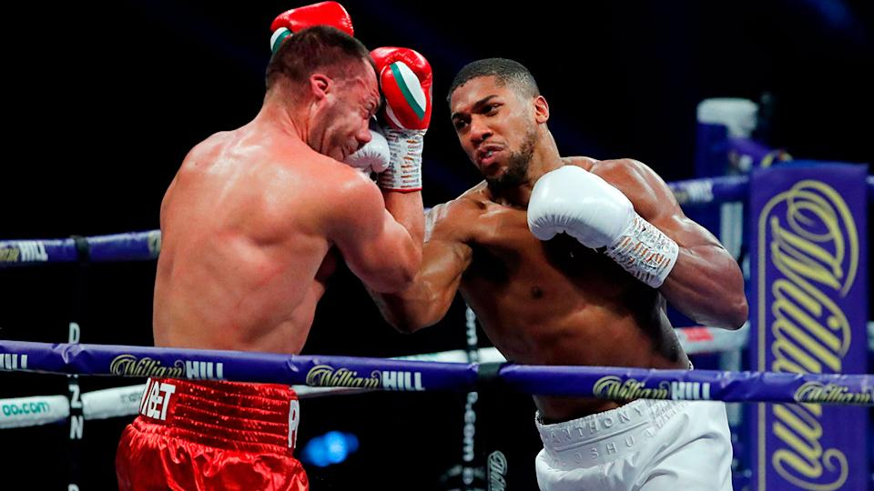 Anthony Joshua can be seen here hitting Kubrat Pulev with a big right uppercut.