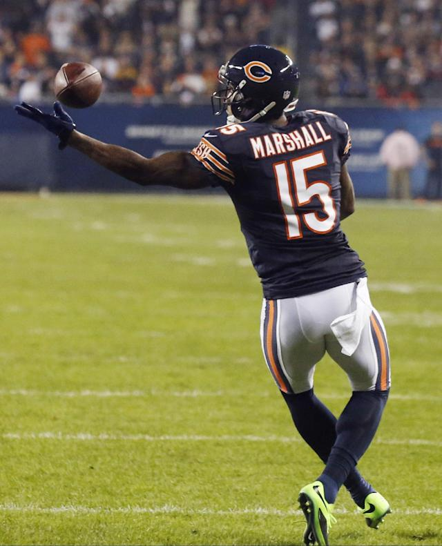 Chicago Bears wide receiver Brandon Marshall misses a pass on fourth-and-goal in the first half of an NFL football game against the New York Giants, Thursday, Oct. 10, 2013, in Chicago. (AP Photo/Charles Rex Arbogast)