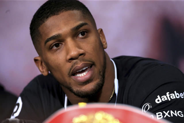 "Britain's Anthony Joshua (20-0, 20 KOs) will meet New Zealand's <a class=""link rapid-noclick-resp"" href=""/ncaaf/players/252304/"" data-ylk=""slk:Joseph Parker"">Joseph Parker</a> in a heavyweight title unification bout in Cardiff on Saturday. (AP)"