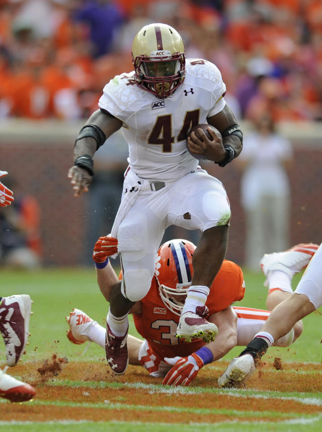 Boston College running back Andre Williams (44) rushes out of the tackle-attempt of Clemson's Scott Shuey during the first half of an NCAA college football game on Saturday, Oct. 12, 2013, in Clemson, S.C. (AP Photo/ Richard Shiro)