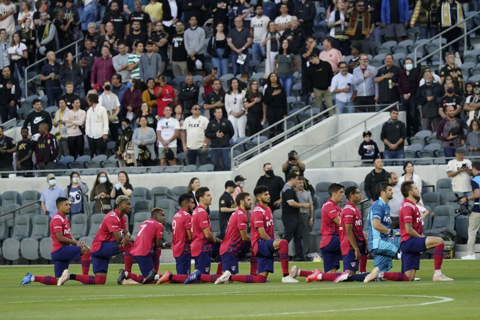 Dallas FC players take a kneed during the national anthem before of an MLS soccer match against Los Angeles FC Wednesday, June 23, 2021, in Los Angeles. (AP Photo/Marcio Jose Sanchez)