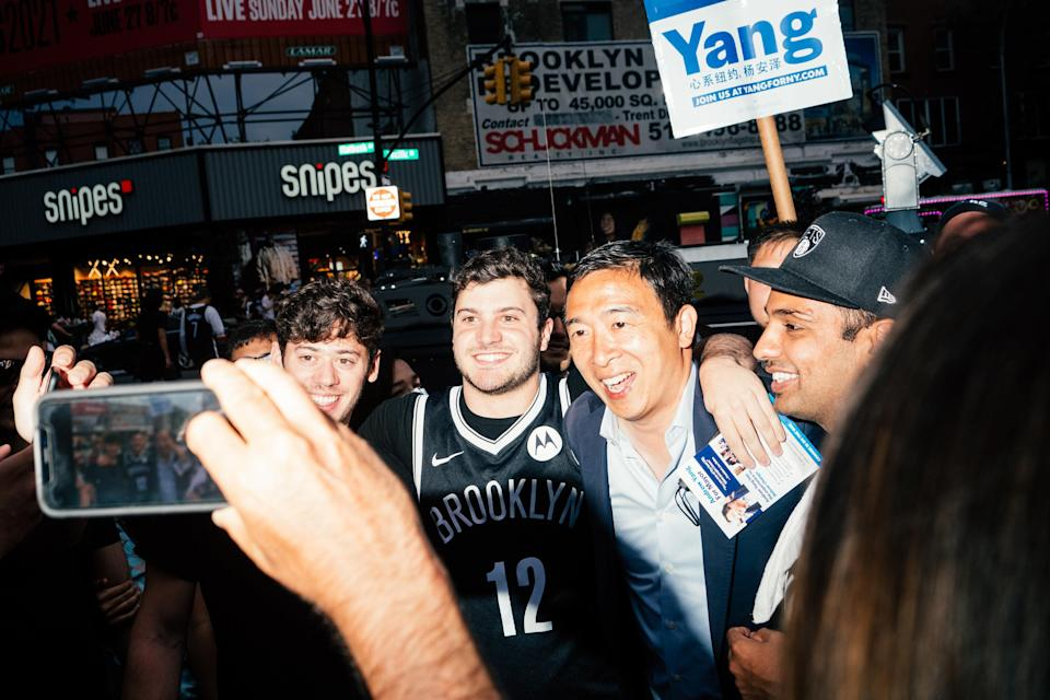 A crowd of Brooklyn Nets fans pose for pictures with Yang outside of Barclay's Center in Brooklyn.