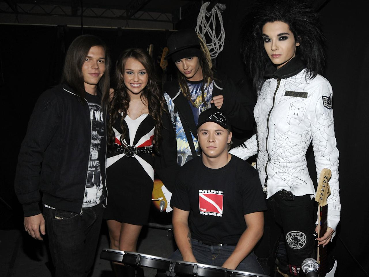 <p>Although Miley lost out to Tokio Hotel for best new artist, she posed for a picture with the group backstage. </p>