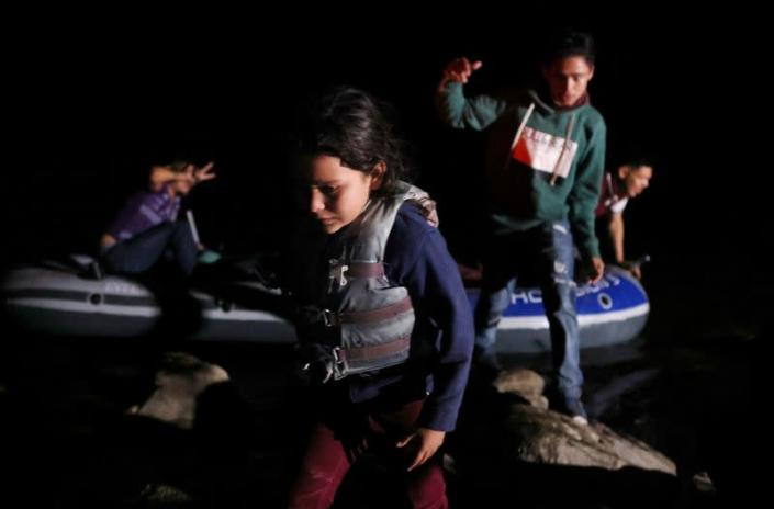 FILE PHOTO: Asylum-seeking migrants cross the Rio Grande river into the United States from Mexico
