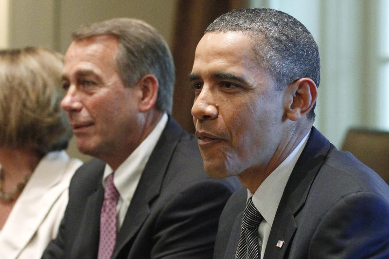 President Barack Obama and House Speaker John Boehner of Ohio, take part in a meeting  in the Cabinet Room of the White House in Washington, Thursday, July 14, 2011, with Republican and Democratic leaders regarding the debt ceiling. (AP Photo/Charles Dharapak)
