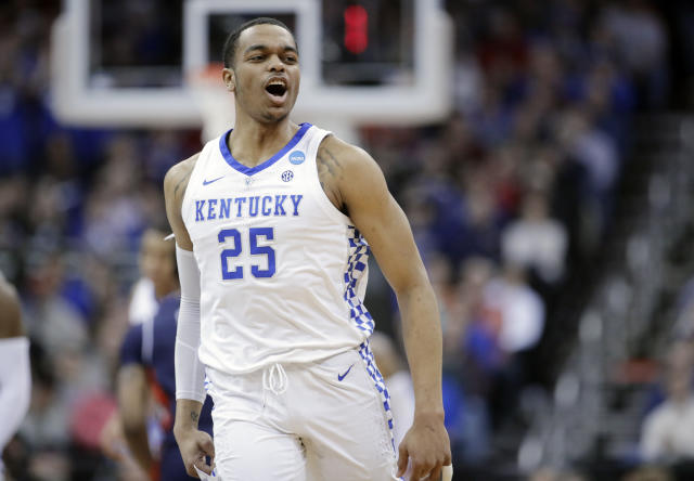 Kentucky's PJ Washington celebrates after making a 3-point basket during the first half of the Midwest Regional final game against Auburn in the NCAA men's college basketball tournament Sunday, March 31, 2019, in Kansas City, Mo. (AP Photo/Charlie Riedel)